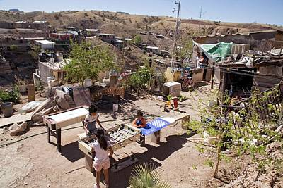 Slums Photograph - Children Playing In A Slum by Jim West