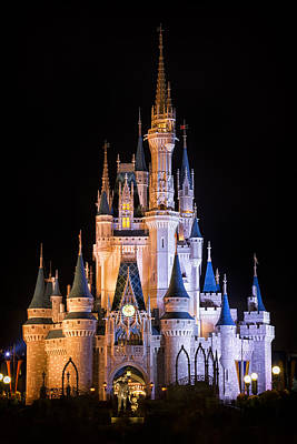 Illuminated Photograph - Cinderella's Castle In Magic Kingdom by Adam Romanowicz