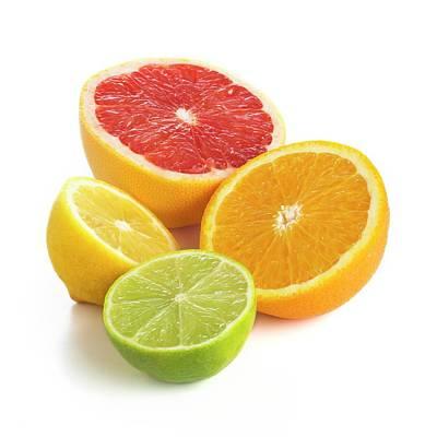 Grapefruit Photograph - Citrus Fruit Halves by Science Photo Library
