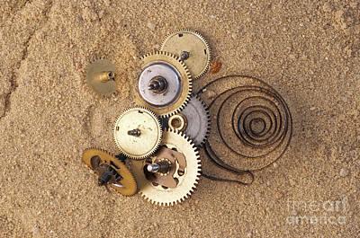 Clockwork Mechanism On The Sand Print by Michal Boubin