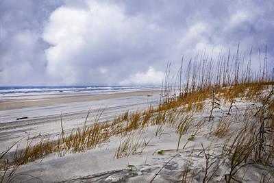 Clouds Over The Dunes Print by Debra and Dave Vanderlaan