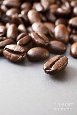 Coffee Beans On Grey Ceramic Surface Print by Colin and Linda McKie
