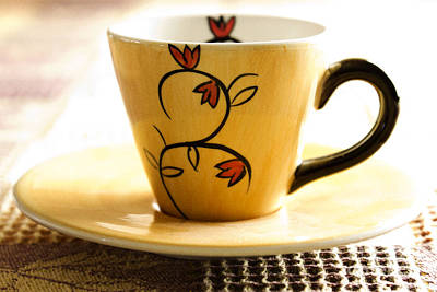 Flower Design Photograph - Coffee Cup by Blink Images