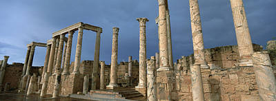 Roman Ruins Photograph - Columns Of Buildings In An Old Ruined by Panoramic Images