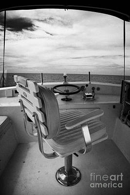Controls On The Flybridge Deck Of A Charter Fishing Boat In The Gulf Of Mexico Print by Joe Fox