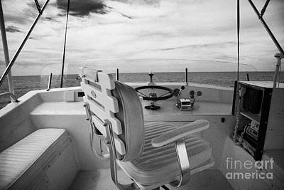 Controls On The Flybridge Deck Of A Charter Fishing Boat In The Gulf Of Mexico Out Of Key West Print by Joe Fox