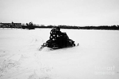 couple on a snowmobile going cross country Kamsack Saskatchewan Canada Print by Joe Fox