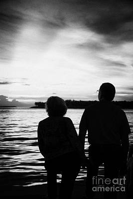 Couple On Waterfront Watching Evening Sunset Celebrations Mallory Square Key West Florida Usa Print by Joe Fox