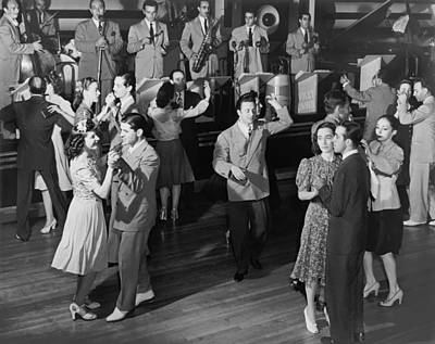 Dance Floor Photograph - Couples Dancing To A Band by Underwood Archives