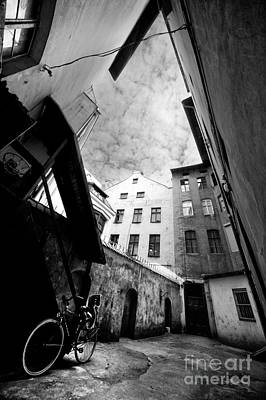 Courtyard With Bike And Buildings In Black And White Print by Jaroslaw Blaminsky