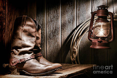 Cowboy Boots In Old Barn Print by Olivier Le Queinec