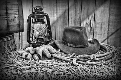 Cowboy Hat And Rodeo Lasso In A Black And White Print by Paul Ward