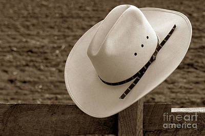 Cowboy Hat On Fence Print by Olivier Le Queinec