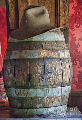 Ghost Town Photograph - Cowboy Hat On Old Wooden Keg by Juli Scalzi