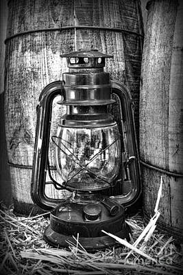 Cowboy Themed Wood Barrels And Lantern In Black And White Print by Paul Ward