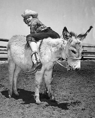 Farm Scene Photograph - Cowgirl Backwards On A Donkey by Underwood Archives