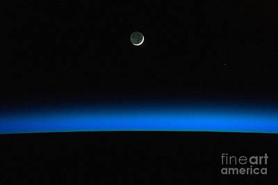 Heavenly Body Photograph - Crescent Moon Over Earth From Iss by Science Source