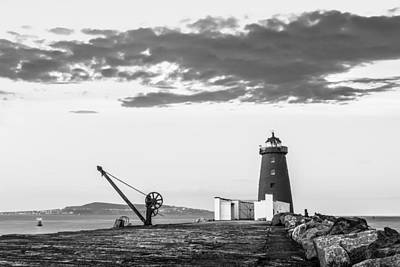 Davit And Lighthouse On A Breakwater Print by Semmick Photo
