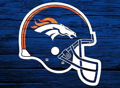 Denver Broncos Football Helmet On Worn Wood Print by Dan Sproul