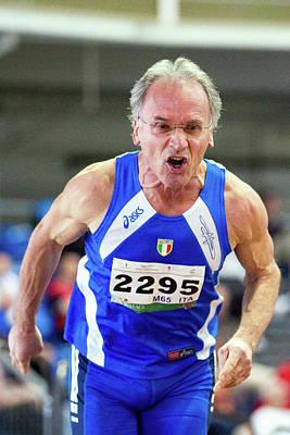 60s Photograph - Determined Senior Athlete by Alex Rotas