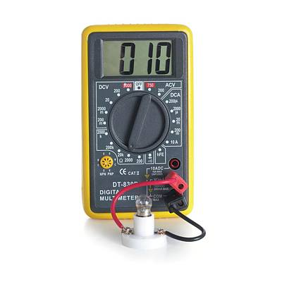 Digital Multimeter With Lightbulb Print by Science Photo Library
