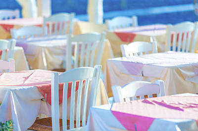 Empty Chairs Photograph - Dining Tables In An Outdoor Restaurant by Wladimir Bulgar