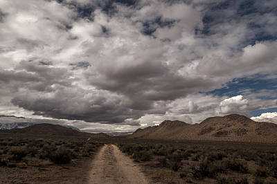 Dirt Road And Clouds Print by Cat Connor
