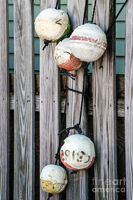 Decrepit Photograph - Distressed Buoys On Fencing Key West by Ian Monk
