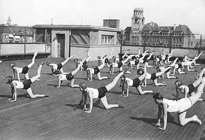 Rooftop Photograph - Donkey Kick Exercising by Underwood Archives