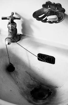 Bathroom Sinks Photograph - Down The Drain by Jerry Cordeiro