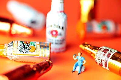 Drinking Among Liquor Filled Chocolate Bottles Print by Paul Ge