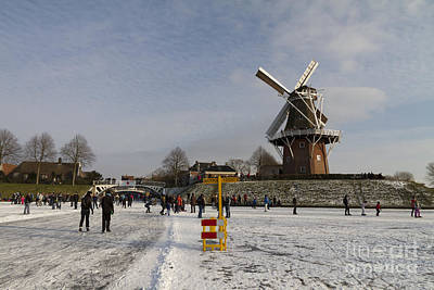 Outlook Photograph - Dutch Winter Scene Skaters And Windmill At Dokkum by Bart De Rijk