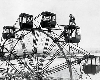 B Photograph - Early Ferris Wheel by MMG Archives