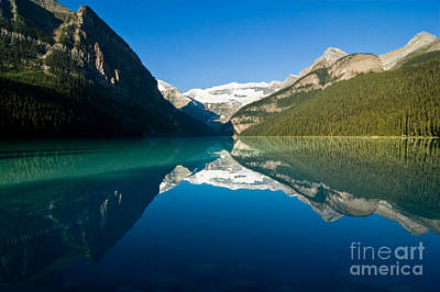 Reflections Photograph - Early Morning At Lake Louise by Oscar Gutierrez