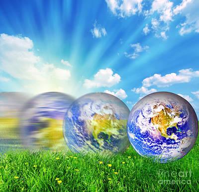 Globe Photograph - Earth Globe Rolling On Green Grass by Michal Bednarek