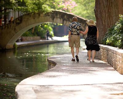 Riverwalk Photograph - Elderly Couple On Riverwalk by Samuel Kessler