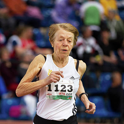 Elderly Female Athlete In Competition Print by Alex Rotas