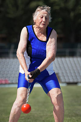 Elderly Woman Competitive Weights Thrower Print by Alex Rotas