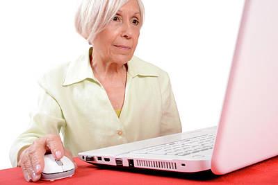 Elderly Woman Using A Laptop Computer Print by Aj Photo