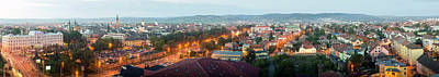 Romania Photograph - Elevated View Of A City Lit Up At Dusk by Panoramic Images