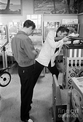 Elvis Presley Photograph - Elvis Presley At An Arcade 1956 by The Phillip Harrington Collection