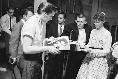 Elvis Presley Backstage Signing Autographs For Fans 1956 Print by The Phillip Harrington Collection