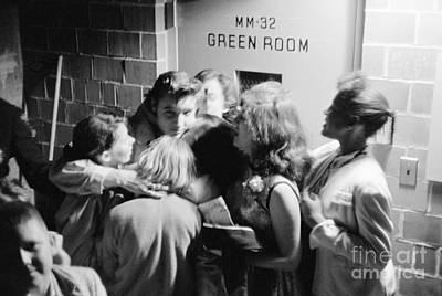 Elvis Presley Photograph - Elvis Presley Hugging Fans 1956 by The Phillip Harrington Collection