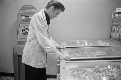 Elvis Presley Photograph - Elvis Presley Playing Pinball 1956 by The Phillip Harrington Collection