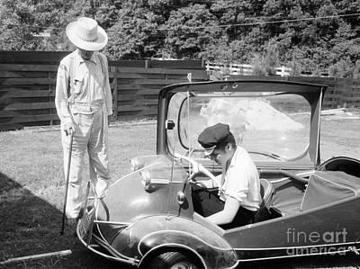 Elvis Presley Photograph - Elvis Presley With His Messerschmitt Micro Car 1956 by The Phillip Harrington Collection