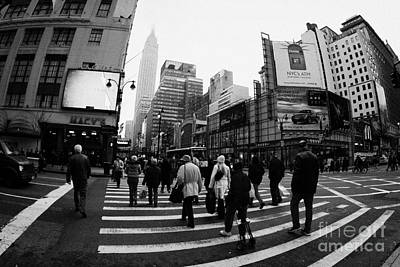 Empire State Building Shrouded In Mist As Pedestrians Crossing Crosswalk  New York City Usa Print by Joe Fox