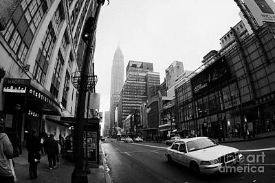 Empire State Building Shrouded In Mist As Yellow Cab Taxi New York City Print by Joe Fox
