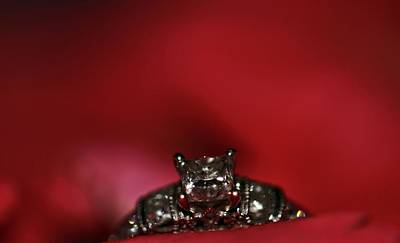 Anniversary Ring Photograph - Engagement Ring On Rose Petals by Dan Sproul