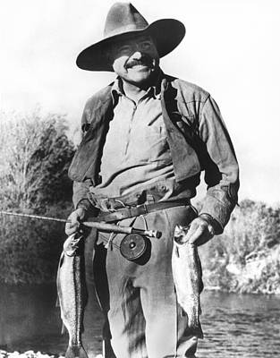 Trout Photograph - Ernest Hemingway Fishing by Underwood Archives