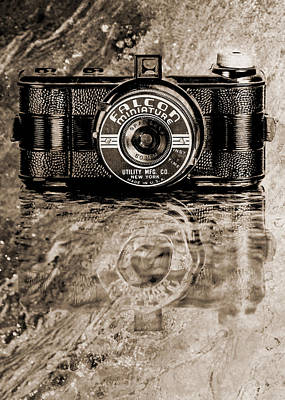 Falcon Miniature Camera With Water Print by Jon Woodhams